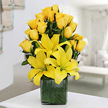 Make Up Her Mood Today - Glass vase arrangement of 20 Yellow Roses, 3 Yellow asiatic lilies.