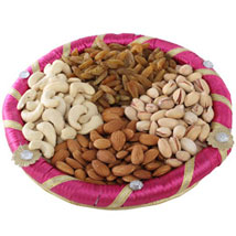 Pink Dry Fruits Round Tray: Send Gourmet Gifts for Him